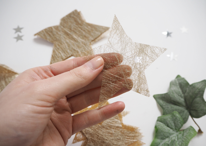 DIY Christmas Tissue Paper Star Garland - cutting out the star