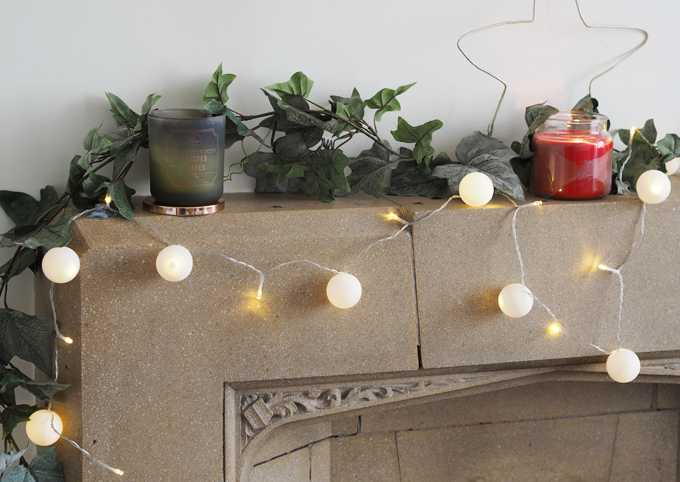 DIY Snowball Fairy Lights using ping pong balls - on the fireplace front