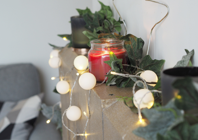DIY Snowball Fairy Lights using ping pong balls - view of the fireplace
