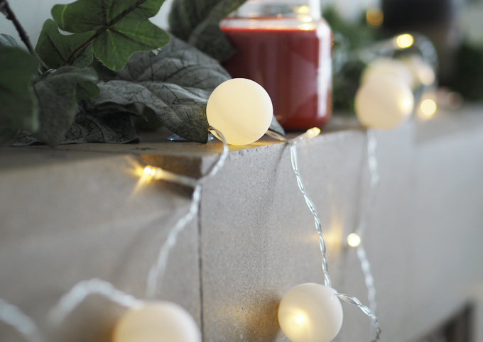 DIY Snowball Fairy Lights using ping pong balls - on the fire place