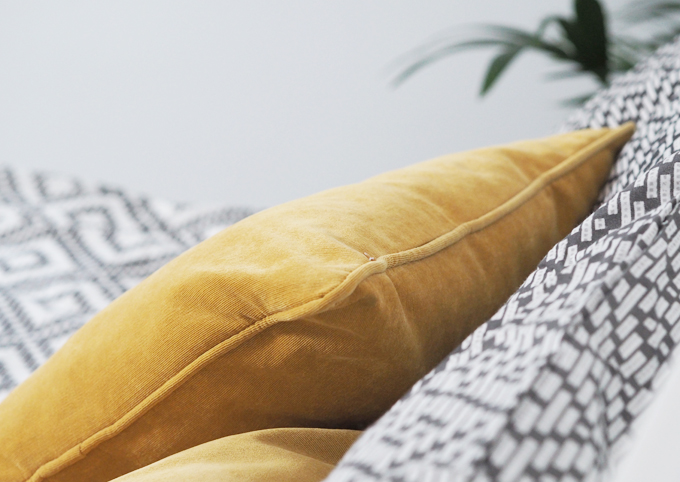 How to refresh your bedroom on a budget - Matalan velour cushions