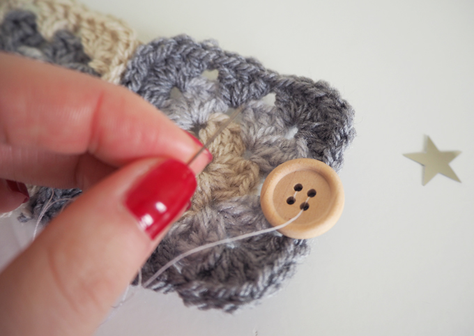 Sewing the button - DIY Crocheted Mug Warmer Free Pattern | MadeUpStyle.com